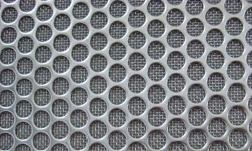 The enlarged view of the perforated sheet which covers the sintered layers.