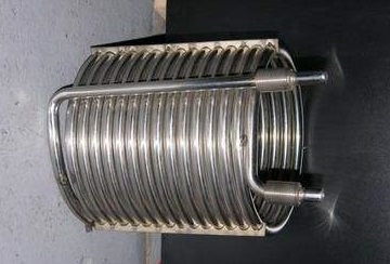 Helical bent-coils made of ASTM B163 seamless tubes.